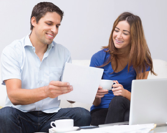 Man and woman looking at paperwork