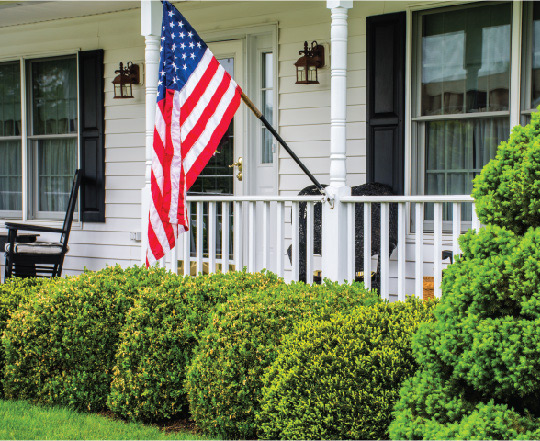 Front porch with American flag